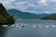 Fishing boats and cruise ship on lake Hakone Royalty Free Stock Photography