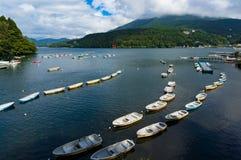 Fishing boats and cruise ship on lake Hakone Royalty Free Stock Image