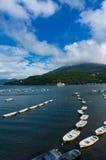 Fishing boats and cruise ship on lake Hakone Stock Photos