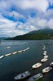 Fishing boats and cruise ship on lake Hakone Royalty Free Stock Photo