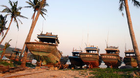 Fishing Boats, Danang - Vietnam. Fishing boats on blocks at sunset. Danang Beach, Vietnam Royalty Free Stock Photo
