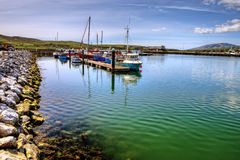Fishing boats in Dingle harbor in summer, Ireland. Royalty Free Stock Photo