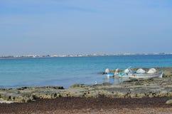 Fishing boats Djerba Tunisia. View on the summer beach. Djerba island Tunisia. Fishing boats Stock Photography