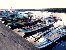 Fishing boats dock at at fish port or pier and replenish their supplies before heading out to sea again. Royalty Free Stock Photos