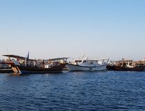 Fishing boats at the dock. Fishing boats in the dock in the evening after a long day of work Royalty Free Stock Image
