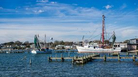 Fishing boats at dock with nets. Fishing boats with nets at dock with seagulls Royalty Free Stock Photo