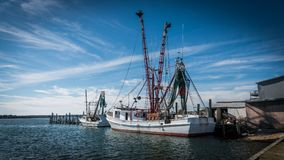 Fishing boats at dock with nets. Fishing boats with nets at dock with seagulls Stock Image