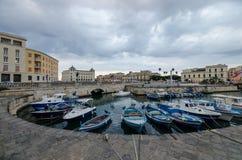 Fishing boats at the dock of Ortigia Syracuse Sicily royalty free stock photography