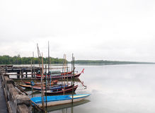Fishing boats at dock with scenic nature background Royalty Free Stock Photo