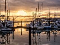 Fishing boats at dock at sunset Royalty Free Stock Photo