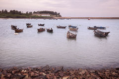 Fishing boats dock at twilight Stock Photo