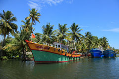 Fishing boats are docked in the Ashtamudi lake Royalty Free Stock Images