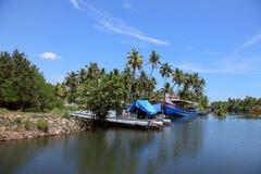 Fishing boats are docked in the Ashtamudi lake Stock Photo