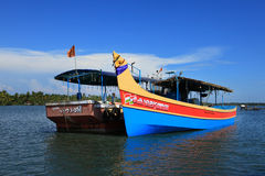 Fishing boats are docked in the Ashtamudi lake Royalty Free Stock Photography
