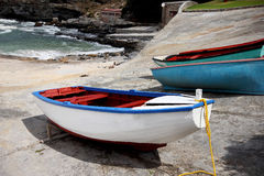 Fishing boats docked. Close up photo of a Cape scene with three fishing boats docked on the rocks Royalty Free Stock Photography