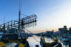 Fishing boats docked at a fishing village. Stock Photo