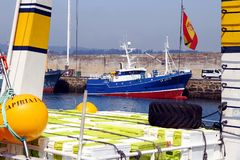 Trawler and longliners fishing boats docked in Celeiro harbor in Spain. Fishing boats docked in the fishing harbor of Celeiro after work all night in the coasts Royalty Free Stock Photography