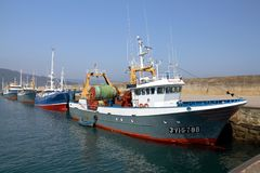 Trawler and longliners fishing boats docked in Celeiro harbor in Spain. Stock Image