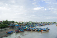 Fishing boats docked at harbor Stock Image
