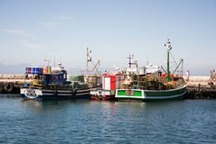 Fishing boats docked in Kalk Bay on sunny day stock images