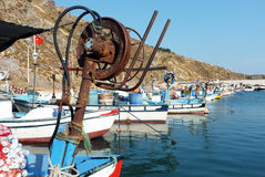 Fishing boats docked by the mountain Stock Photography