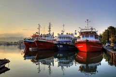 Fishing boats on early morning on calm sea Stock Image