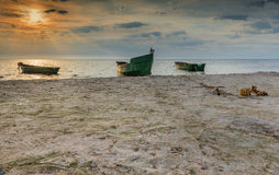 Fishing boats early in the morning on sandy beach of the Baltic Sea, Latvia, Europe Royalty Free Stock Photography