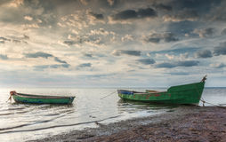 Fishing boats early in the morning on sandy beach of the Baltic Sea, Latvia, Europe Royalty Free Stock Image