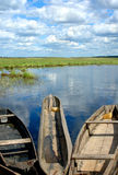 Fishing boats on the edge of water-meadow Stock Photos