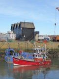 Fishing boats in harbour. The fishing port of Whitstable in Kent, England Royalty Free Stock Image