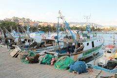 Fishing boats and nets. Fishing boats and equipment such as nets in the Italian port of La Spezia royalty free stock photos