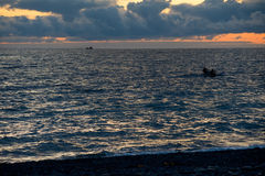 Fishing boats in the evening sea. Fishing boats in the sea Royalty Free Stock Photos