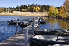 Fishing Boats and Fall Colors In Arizona. A dock with fishing boats surrounded by fall colors in the Apache National Forest stock images