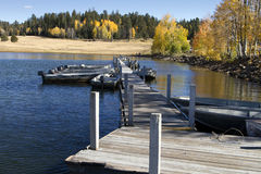 Fishing Boats and Fall Colors In Arizona. A dock with fishing boats surrounded by fall colors in the Apache National Forest stock image