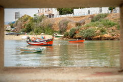 Fishing boats in Ferragudo, Algarve, Portugal. Fishing boats moored in the river at Ferragudo, Portugal Stock Photo