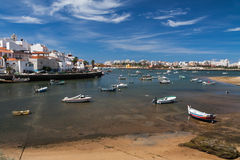 Fishing boats in Ferragudo harbor Stock Images