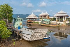 Fishing boats and ferry moored on the coast in Fishing Village o Royalty Free Stock Images