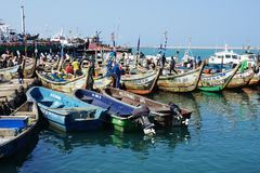 Fishing boats in the ficher harbor of Lome in Togo royalty free stock image
