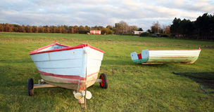 Fishing boats on field Royalty Free Stock Photos