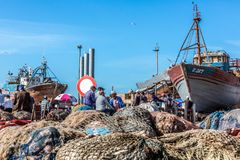 Fishing Boats and fishermen in dry dock at the harbor in Essaouira, Morocco Royalty Free Stock Photography