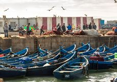 Fishing Boats and fishermen in the harbor in Essaouira, Morocco Stock Photos