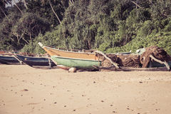 Fishing boats and  fishing nets on a tropical beach Royalty Free Stock Image