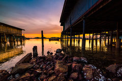 Fishing boats and fishing village sunset Royalty Free Stock Image