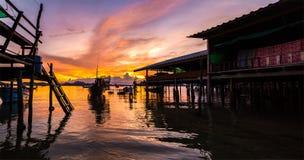 Fishing boats and fishing village sunset Royalty Free Stock Photo