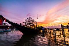 Fishing boats and fishing village sunset Stock Photos