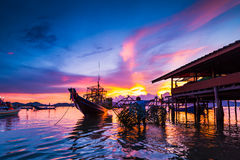 Fishing boats and fishing village sunset Royalty Free Stock Photos