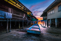 Fishing boats and fishing village sunset Royalty Free Stock Images