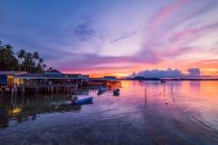 Fishing boats and fishing village sunset Stock Image