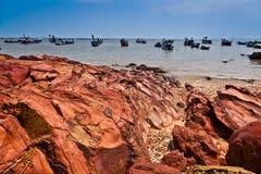 Fishing Boats Fleet. Anchored at sea of the shore of Kampung Pulau Sayak, Kedah, Malaysia with natural rock formation in the foreground Royalty Free Stock Images