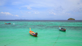 Fishing boats float on crystal Andaman sea Royalty Free Stock Photography